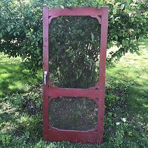 Old farmhouse screen door, wood. Garden Decor. Basement Door