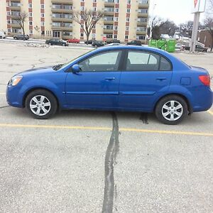 Kia Rio 33,600km. $6.550. Immaculate condition fully loaded