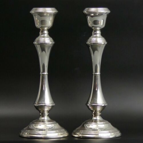 A PAIR OF ELIZABETH II SILVER CANDLESTICKS BIRM. 1973 - 1060 GRAMS (WEIGHTED)