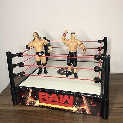 WWE RAW Spring-loaded Wrestling Ring - Including Triple H & John Cena WWF Figure