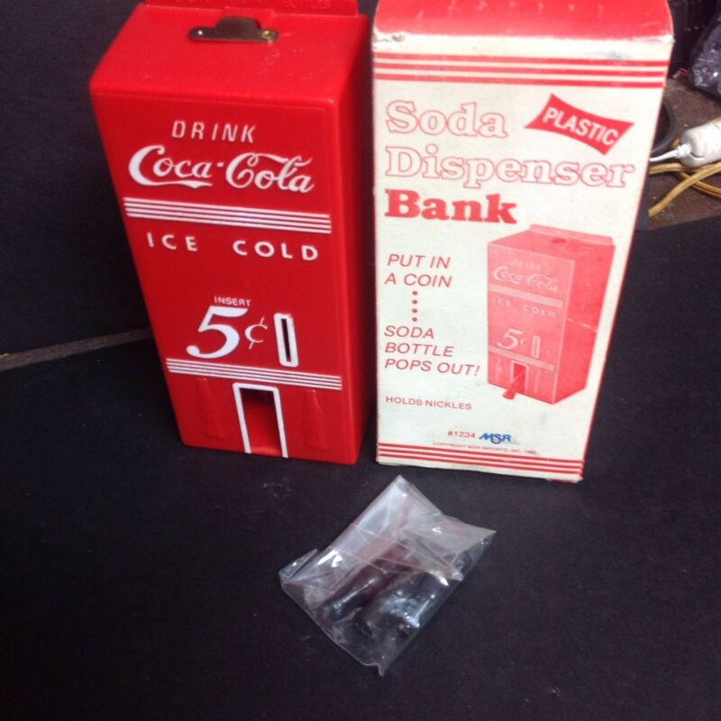 Coca Cola Plastic Dispenser Bank With Bottles