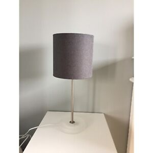 Table lamp, grey shade and matte clear base