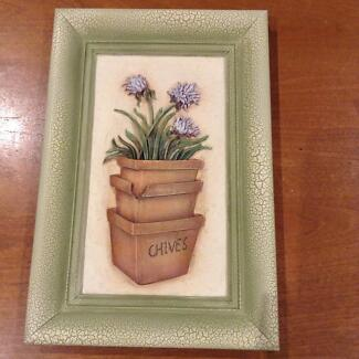 Pottery wall plaque of a pot of chives