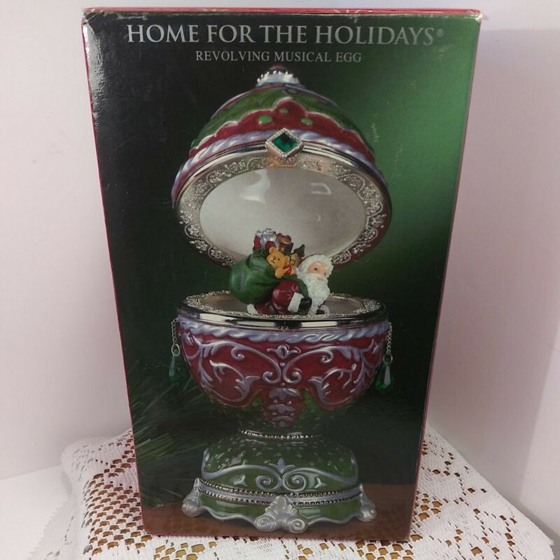 Vintage Home for the Holidays Christmas Revolving Musical Egg Santa Clause. New