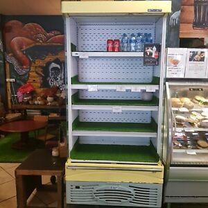 Upright open fridge
