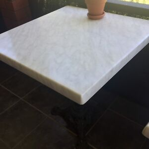 Cafe tables cast iron bases, reduce, $40 each