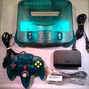 Turquoise Nintendo 64 with controller.