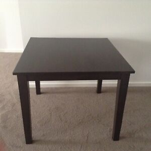 Dark brown wooden dining table