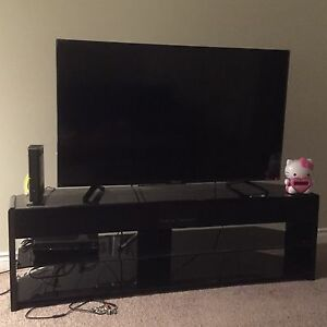 "Hisense 55"" 4K UHD Smart Television and stand"