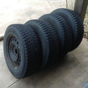 215/70 R16 Dunlop Grandtrek SJ6 tires on rims off Saturn Vue