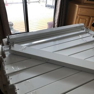 12 Double and two single, 4 foot fluorescent lights with bulbs