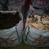 dry black hard peats/ turf and dry firewood logs sold in bulk bags