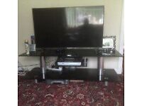 tv stand for large tv in black and chrome finnish mint condition