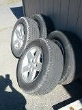 TIRES AND RIMS P245/65R17