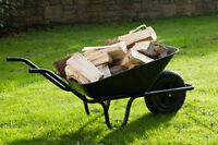 Wheel barrel full of dry wood for fireplace or stove