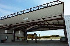 POWERLIFT HYDRAULIC DOORS -  For Quonsets, Pole Shed, Wood Structures, Steel Structures, and more!