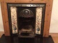 Ornate tiled cast iron fireplace insert
