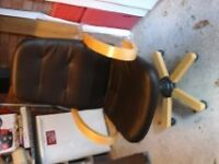 Dark brown leather look and wood swivel office chair