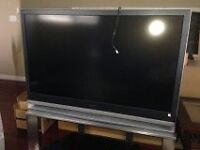 """56 """" Sony T.V with stand"""