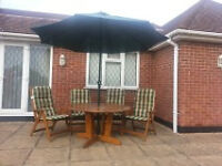 Patio Table, Chairs and Parasol Set.