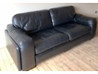 Large 3 seater and 2 seater black leather sofas