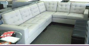 Beige fabric sectional - brand new still in box.