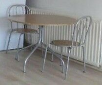 We are moving this week, Argos dinning table and four chairs £35 Original price £90