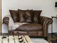 Brown leather cuddler couch