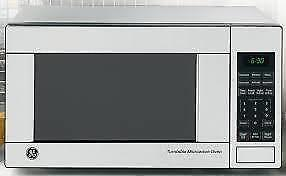 NEW stainless MICROWAVE 1100 WATTS/ MICRO-ONDE NEUF