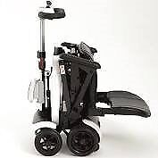 Genie + mobility scooter. Top of the range. Remote control fold/unfold. Used once
