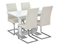 White, high gloss Nova extending dining room table and 4 matching chairs.