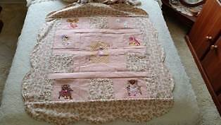 Handmade embroidered cot quilt or knee rug
