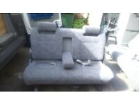 2 double seats which convert into double bed on rails