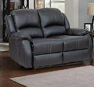 New in Boxes!!!  Black Reclining Love Seat in a PU Material Regular $899 Now $349.  Tax Free until Labor Day.
