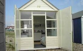 Beach hut to let in Alum Chine , fully kitted out with all you would need for a great day .