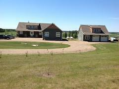 Beautiful home with 80 acres of farm land 8 kms from Red Deer