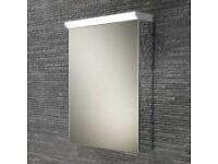 Single door cabinet with LED top light, soft close, internal charging socket, adjustable shelves.