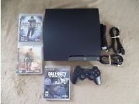 Play station 3 with 2 controllers plus 10 games