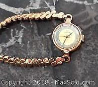 Omega ladies watch and pearl necklace with gold clasp.