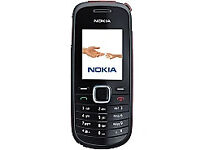 Boxed Nokia 1661 Unlocked mobile phone with charger and earphones