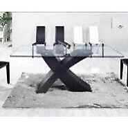 Heavy glass dining table with black wooden base