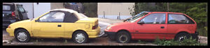 Yellow 1992 3 cylinder Geo Metro LSI  and Red 1991 Firefly.