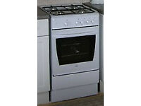 Four-burner gas cooker with oven, good condition