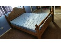 Double pine bed frame + mattress. Both used second hand condition
