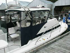 25' Canoe Cove Express with Hardtop and Boathouse