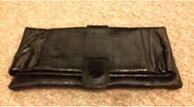 C Faith patent clutch bag never been used