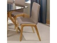 A beautiful dining room table and chairs for sale.