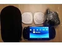 Psp 2000 console, 4gb memory, charger & 2 games