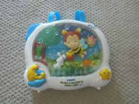 Exersaucer and crib toy