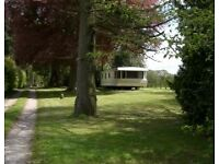 Hobground Holiday Home is a single standing, static caravan in its own setting, among 12 acres .